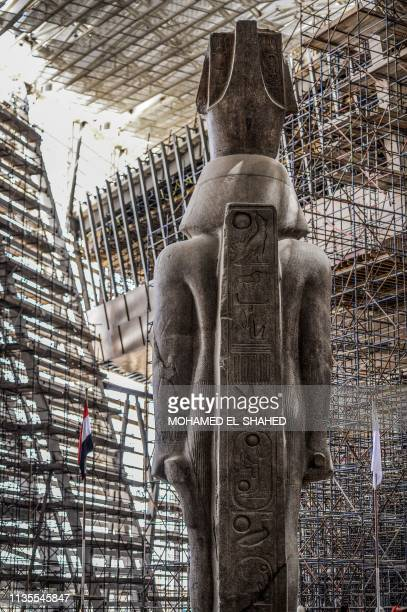 This picture taken on April 7, 2019 shows a view of the back of the colossus of ancient Egyptian Pharaoh Ramesses II, at its permanent display spot...