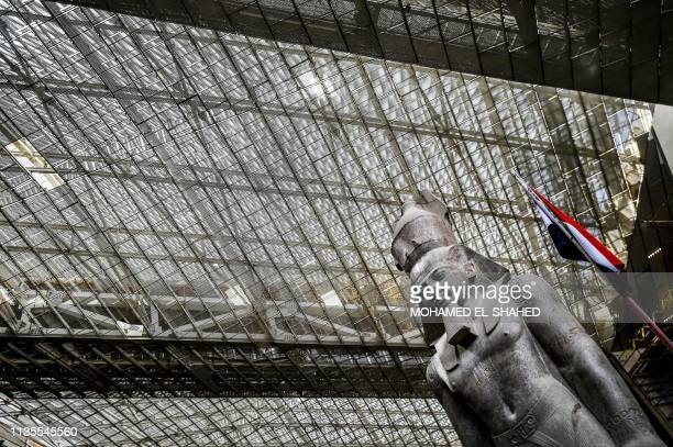 TOPSHOT This picture taken on April 7 2019 shows the colossus of ancient Egyptian Pharaoh Ramses II at its permanent display spot in the newlybuilt...