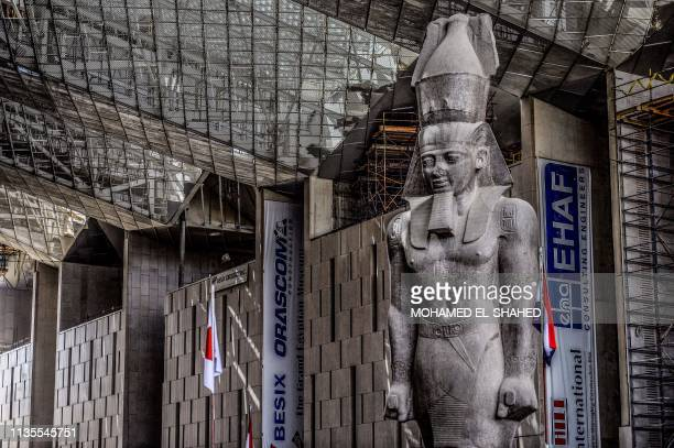 This picture taken on April 7 2019 shows the colossus of ancient Egyptian Pharaoh Ramses II at its permanent display spot in the newlybuilt Grand...