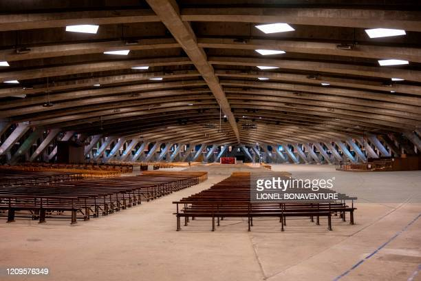 This picture taken on April 9, 2020 in Lourdes, southwestern France shows the deserted Saint Pie X Basilica in the Sanctuary of Our Lady of Lourdes,...