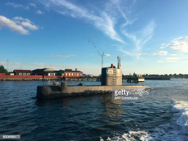 This picture taken on August 10 2017 shows a woman standing in the tower of the private submarine 'UC3 Nautilus' in Copenhagen Harbor The submarine...
