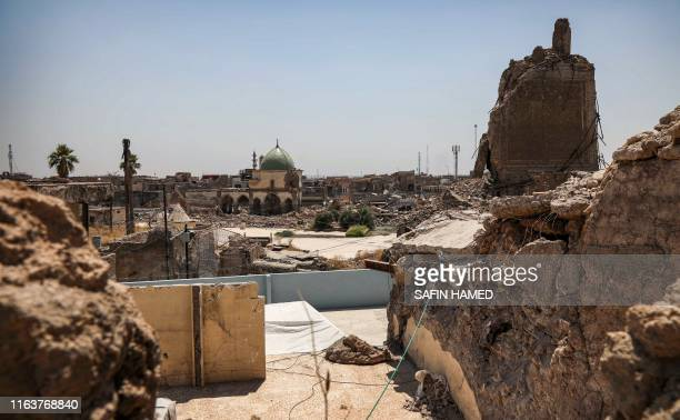 This picture taken on August 10 2019 shows a view of the damaged site of the Great Mosque of alNuri in Iraq's warravaged Old City of Mosul and the...