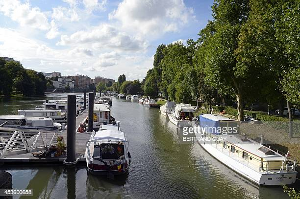 This picture taken on August 12, 2014 shows boats moored on the Marne river, in Joinville-le-Pont, east of Paris. AFP PHOTO/BERTRAND GUAY