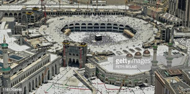 TOPSHOT This picture taken on August 12 2019 shows an aerial view of the Kaaba Islam's holiest shrine its encompassing Grand Mosque in Saudi Arabia's...