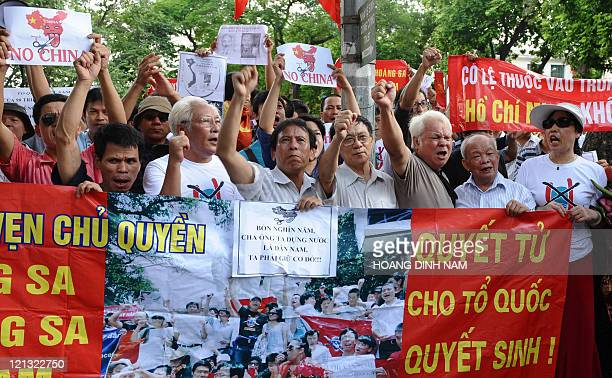 This picture taken on August 14 2011 shows Vietnamese protesters shouting and holding antiChina posters during an antiChina rally in the center of...