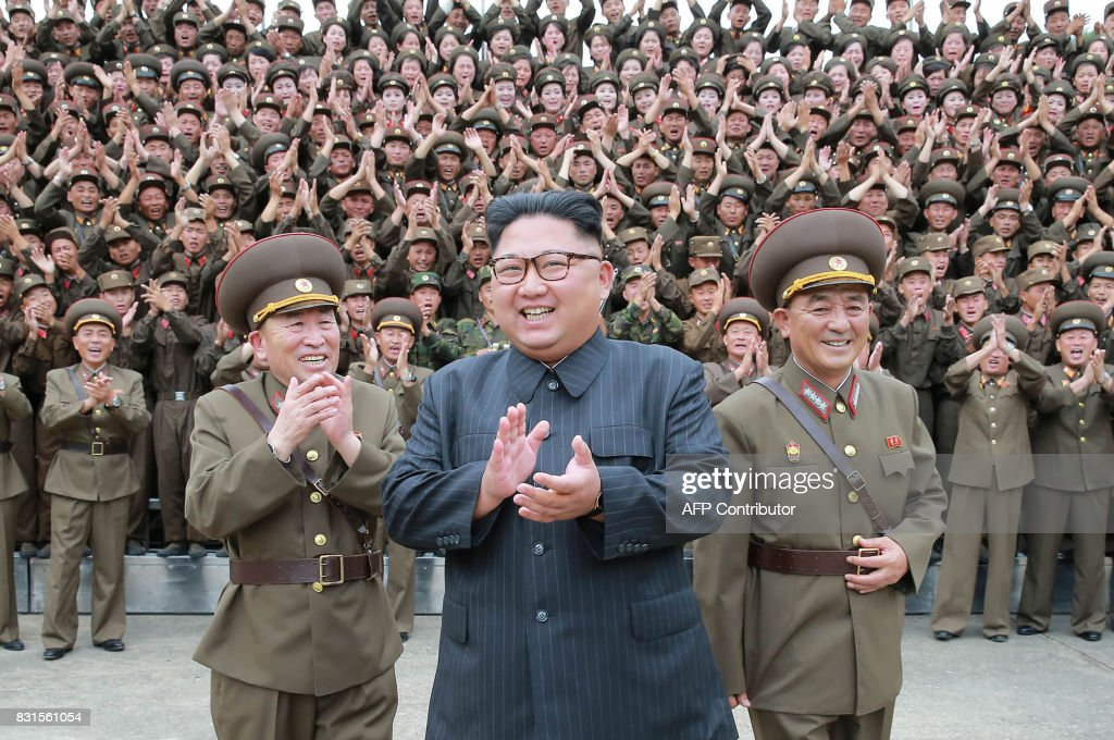 This picture taken on August 14, 2017 and released from North Korea's official Korean Central News Agency (KCNA) on August 15, 2017 shows North Korean leader Kim Jong-Un (C) inspecting the Command of the Strategic Force of the Korean People's Army (KPA) at an undisclosed location. North Korean leader Kim Jong-Un said on August 15 he would hold off on a planned missile strike near Guam, but warned the highly provocative move would go ahead in the event of further 'reckless actions' by Washington. / AFP PHOTO / KCNA VIA KNS / STR / South Korea OUT / REPUBLIC OF KOREA OUT ---EDITORS NOTE--- RESTRICTED TO EDITORIAL USE - MANDATORY CREDIT 'AFP PHOTO/KCNA VIA KNS' - NO