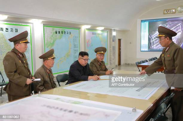 This picture taken on August 14 2017 and released from North Korea's official Korean Central News Agency on August 15 2017 shows North Korean leader...