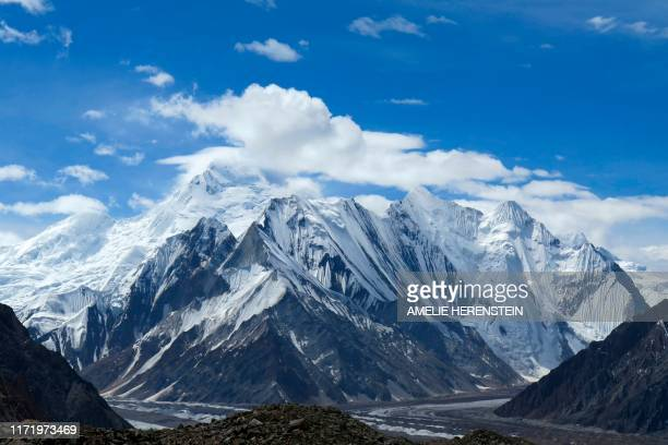 This picture taken on August 15 2019 shows a view of snowcapped mountains and glaciers from the Concordia camping site in the Karakoram range of...
