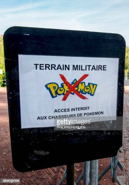 This picture taken on August 16 2016 shows a board forbidding to play the 'Pokemon Go' app inside the 'Citadelle' military area in Lille northern...