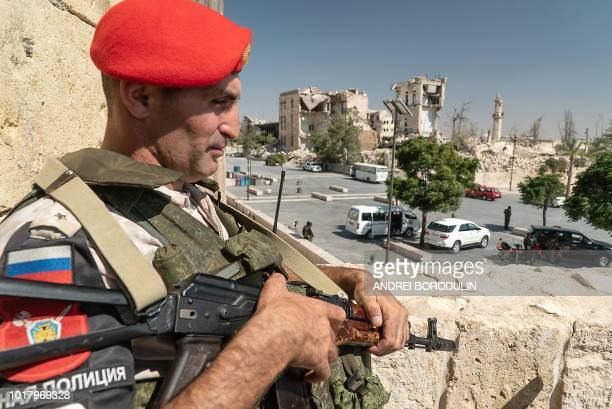 This picture taken on August 16 2018 during a guided tour by the Russian Forces in Syria shows a Russian military police officer in the citadel of...
