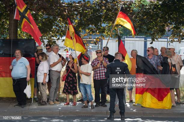 This picture taken on August 16 2018 in Dresden eastern Germany shows antiIslam Pegida movement supporters demonstrating on the occasion of German...