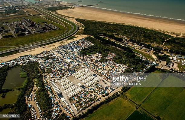 This picture taken on August 16 in Calais shows an aerial view of the jungle camp where over 9000 migrants live according to different NGOs / AFP /...