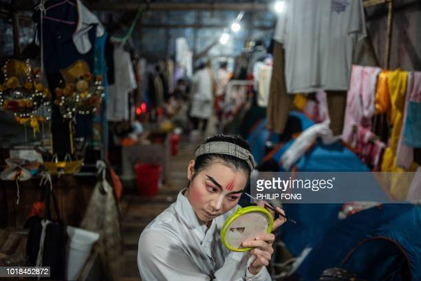 TOPSHOT This picture taken on August 17 2018 shows a Chiu Chow opera actress preparing for a performance during an event to mark the Hungry Ghost...