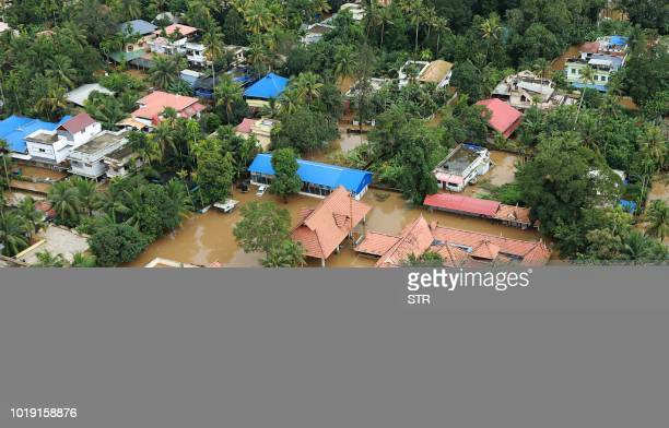 This picture taken on August 18 2018 shows a view of a flooded area in the north part of Kochi in the Indian state of Kerala Rescuers waded into...