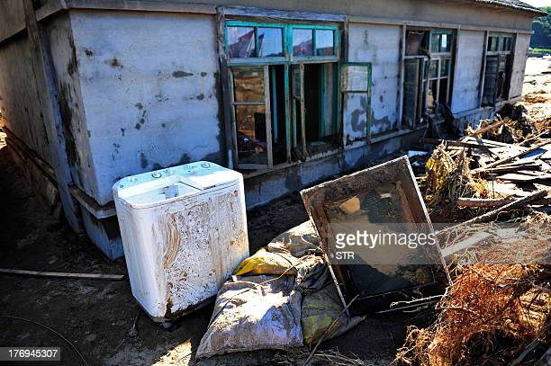 This picture taken on August 19 2013 shows a damaged house after floods hit the Qingyuan Manchu autonomous county of Fushun in northeast China's...
