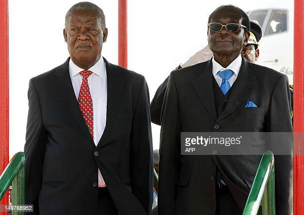 This picture taken on August 2 2012 shows Zimbabwean President Robert Mugabe flanked by Zambian President Michael Sata watching proceedings of the...