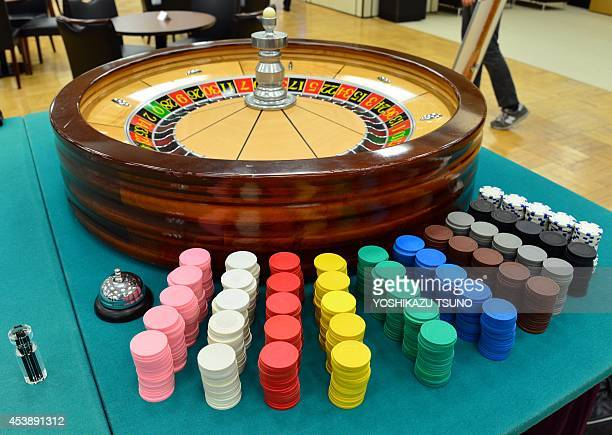 This picture taken on August 20 2014 shows a roulette table being displayed at a Tokyo department store Nearly five percent of Japanese adults are...
