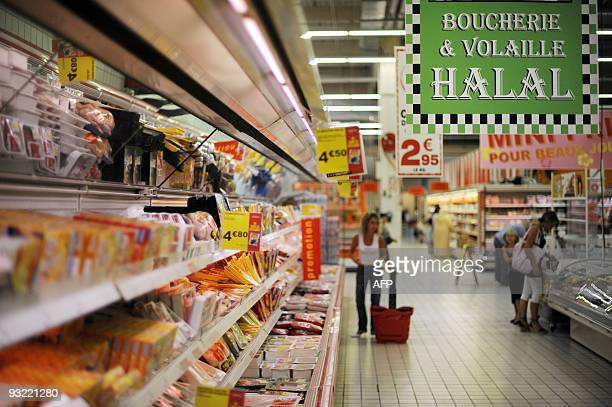This picture taken on August 21, 2009 in Illzach, eastern France, shows the Halal butchery and poultry shelves in a supermarket, on the eve of the...