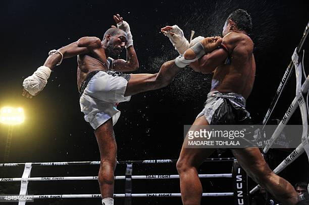 This picture taken on August 22 2015 shows Alka of Belgium and Tengneng of Thailand fighting during a Muay Thai event in Sungai Kolok in the southern...