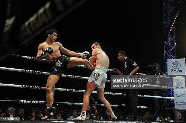 This picture taken on August 22 2015 shows Antoine Pinto of France and Charlie Guest of England fighting during a Muay Thai event in Sungai Kolok in...