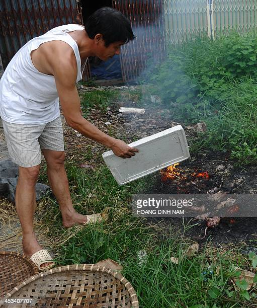 This picture taken on August 23 2013 shows Thanh owner of a rat restaurant roasting rats in Dan Phuong on the outskirts of Hanoi In somes areas in...