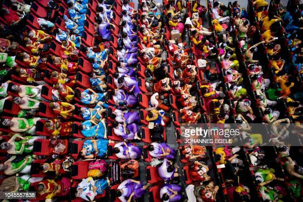 This picture taken on August 25 2018 shows square dancers sit in the audience room at the final round of a citywide square dance competition at a...