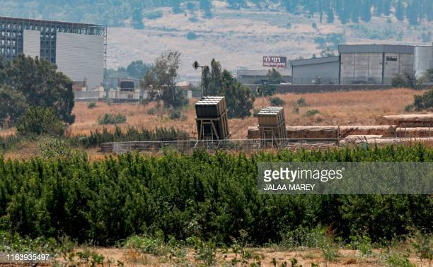 This picture taken on August 25, 2019 shows a view of a battery of Israel's Iron Dome defence system, designed to intercept and destroy incoming...