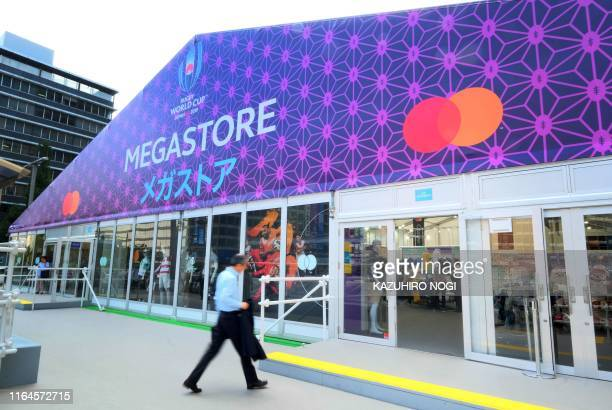 This picture taken on August 26 2019 shows a customer entering the Rugby World Cup 2019 megastore in Tokyo's bustling Shinjuku district With just...
