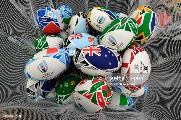 This picture taken on August 26, 2019 shows replicas of the Rugby World Cup 2019 official ball at the event's megastore in Tokyo's bustling Shinjuku...