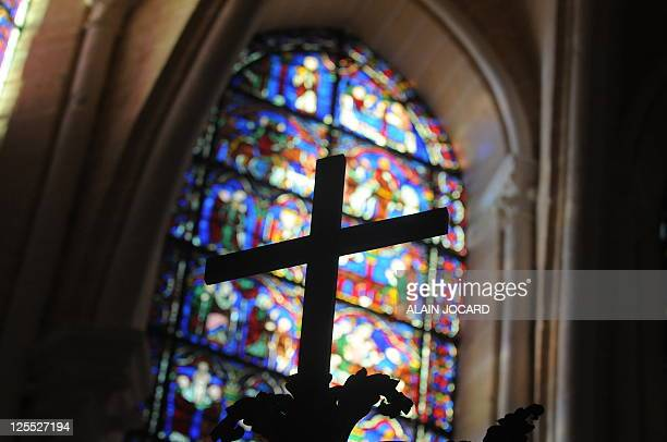 This picture taken on August 26 shows a stained glass window of one the three restored chapels of Cathedral of Chartres western France The Cathedral...