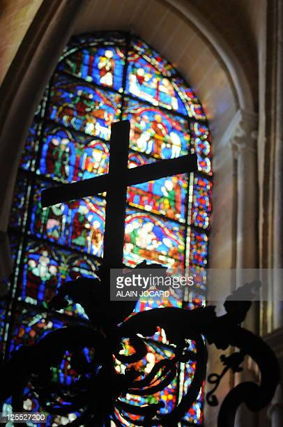 This picture taken on August 26 shows a stained glass window of one of the three restored chapels of Cathedral of Chartres western France The...