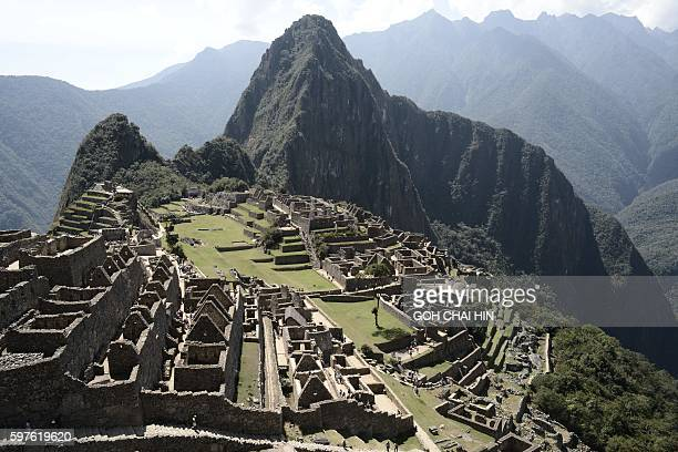 This picture taken on August 27 2016 shows Machu Picchu which stands 2430 meters above sealevel Embedded within a dramatic landscape at the meeting...