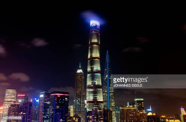 This picture taken on August 27 2018 shows clouds passing Jin Mao Tower the Shanghai Tower and the Shanghai World Financial Center in the financial...