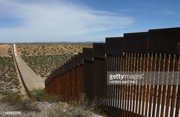 TOPSHOT This picture taken on August 28 2019 shows a portion of the wall on the USMexico border seen from Chihuahua State in Mexico some 100 km from...