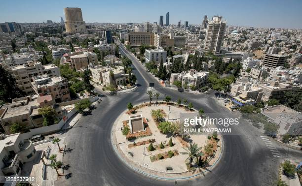 This picture taken on August 28, 2020 shows a view of an empty roundabout during a COVID-19 coronavirus pandemic curfew in the centre of Jordan's...