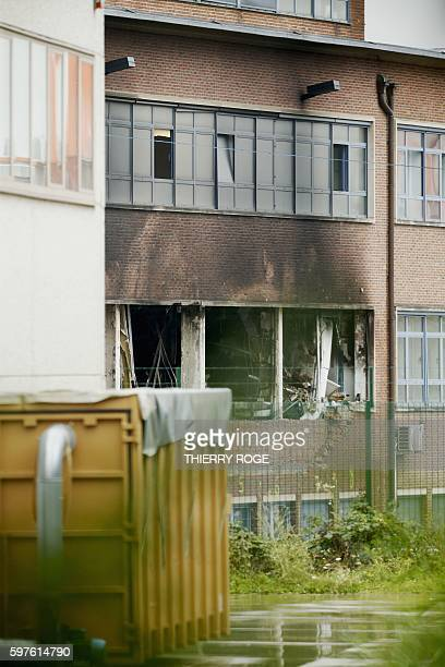 This picture taken on August 29 shows damaged windows ans walls of the National Institute for Criminalistics and Criminology after an fire occurred...