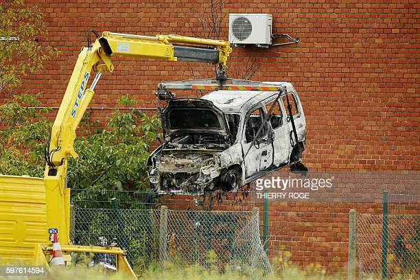This picture taken on August 29 shows the burnt car used to ram raid the National Institute for Criminalistics and Criminology overnight in...