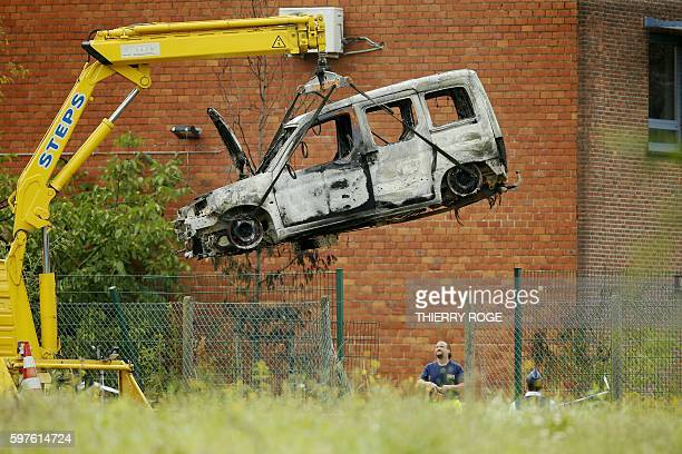 TOPSHOT This picture taken on August 29 shows the burnt car used to ram raid the National Institute for Criminalistics and Criminology overnight in...
