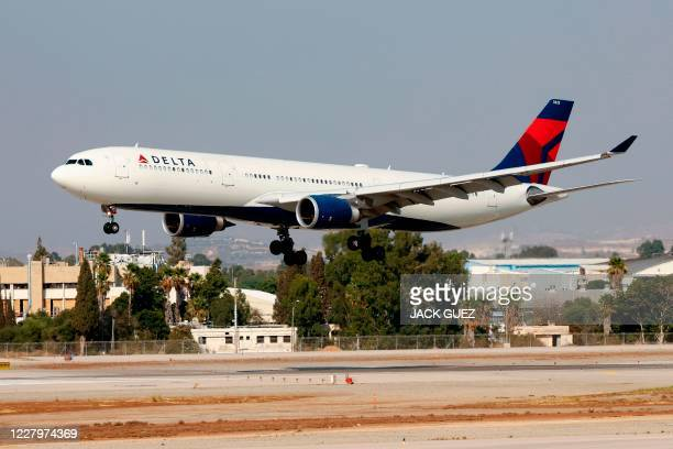 This picture taken on August 3, 2020 shows a Delta Air Lines Airbus A330-300 aircraft landing at Israel's Ben Gurion International Airport in Lod,...