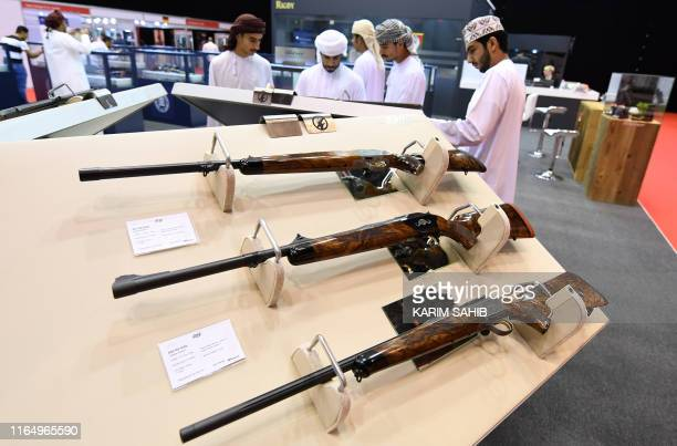This picture taken on August 31 2019 shows bolt action rifles on display during the Abu Dhabi International Hunting and Equestrian exhibition in the...