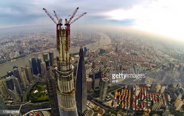 This picture taken on August 4 2013 shows a general view of the underconstruction Shanghai Tower and the 492m Shanghai World Financial Center the...