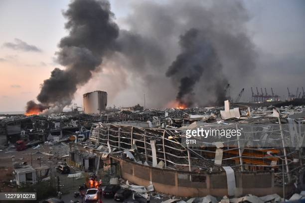 TOPSHOT This picture taken on August 4 2020 shows a general view of the scene of an explosion at the port of Lebanon's capital Beirut Two huge...