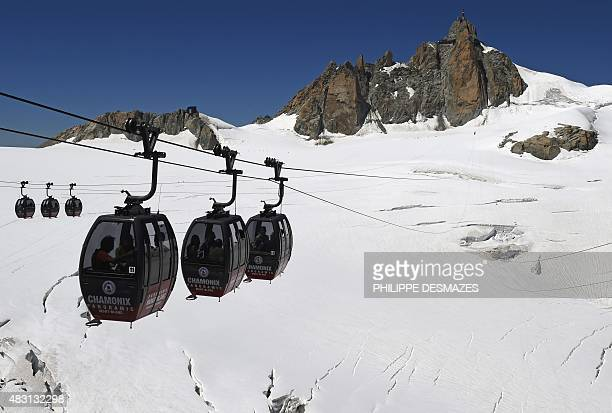 This picture taken on August 5 2015 shows the Panoramic MontBlanc cable car linking the Aiguille du Midi peak to the Helbronner peak in Italy above...