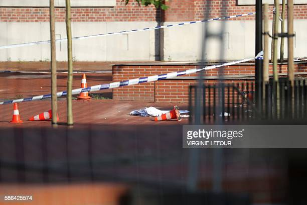 This picture taken on August 6 2016 shows a blanket on the ground in the area around a police building after a man wounded two policewomen with a...