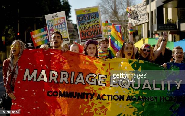 This picture taken on August 6 2017 shows supporters of marriage equality at a protest march in Sydney A bitter political stoush over legalising gay...