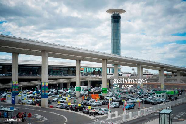 This picture taken on August 8 shows a car park and the control tower south of RoissyCharles de Gaulle airport in RoissyenFrance north of Paris