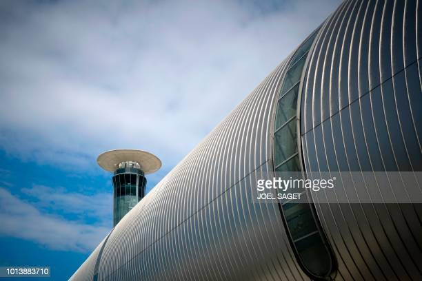 This picture taken on August 8 shows the building of the Terminal 2E and the control tower south of RoissyCharles de Gaulle airport in RoissyenFrance...