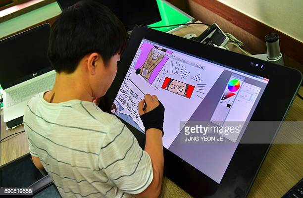 This picture taken on August 9 2016 shows North Korean defector Choi SungGuk editing his weekly online comic cartoon called 'Rodong Simmun ' at his...