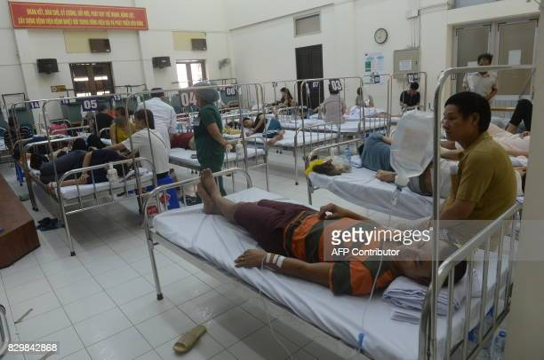This picture taken on August 9 2017 shows patients being treated for dengue fever at a public hospital in Hanoi Official local media has reported at...