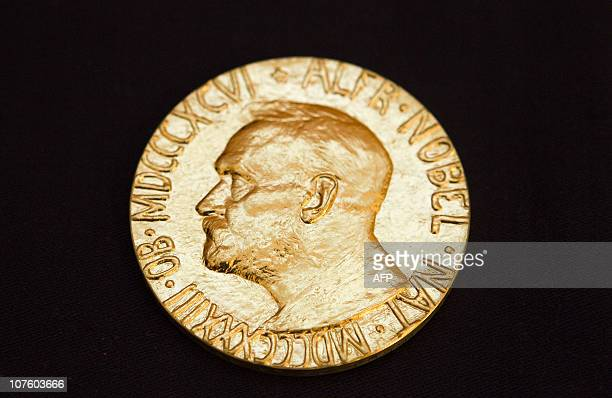 This picture taken on December 10, 2010 shows the front of the Nobel medal awarded to the Nobel Peace Prize laureate for 2010, jailed Chinese...